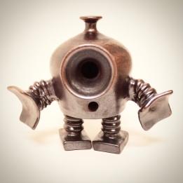 Brown little robot in cermaic